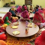 Traditional Indian Women Taking a Shot at Liquor